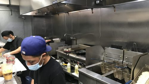 Main Image: People working in industrial kitchen
